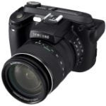 "Digimax 8801089758514 8 Megapixel Bridge Camera - 7.20 mm-108 mm - Black (8.9 cm 3.5"" LCD - 15x Optical Zoom - 3264 x 2448 Image - 640 x 480 Video - PictBridge)"