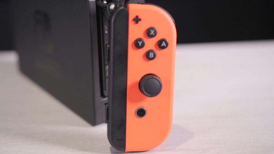 Nintendo Switch in the dock as Joy-Con controllers slapped