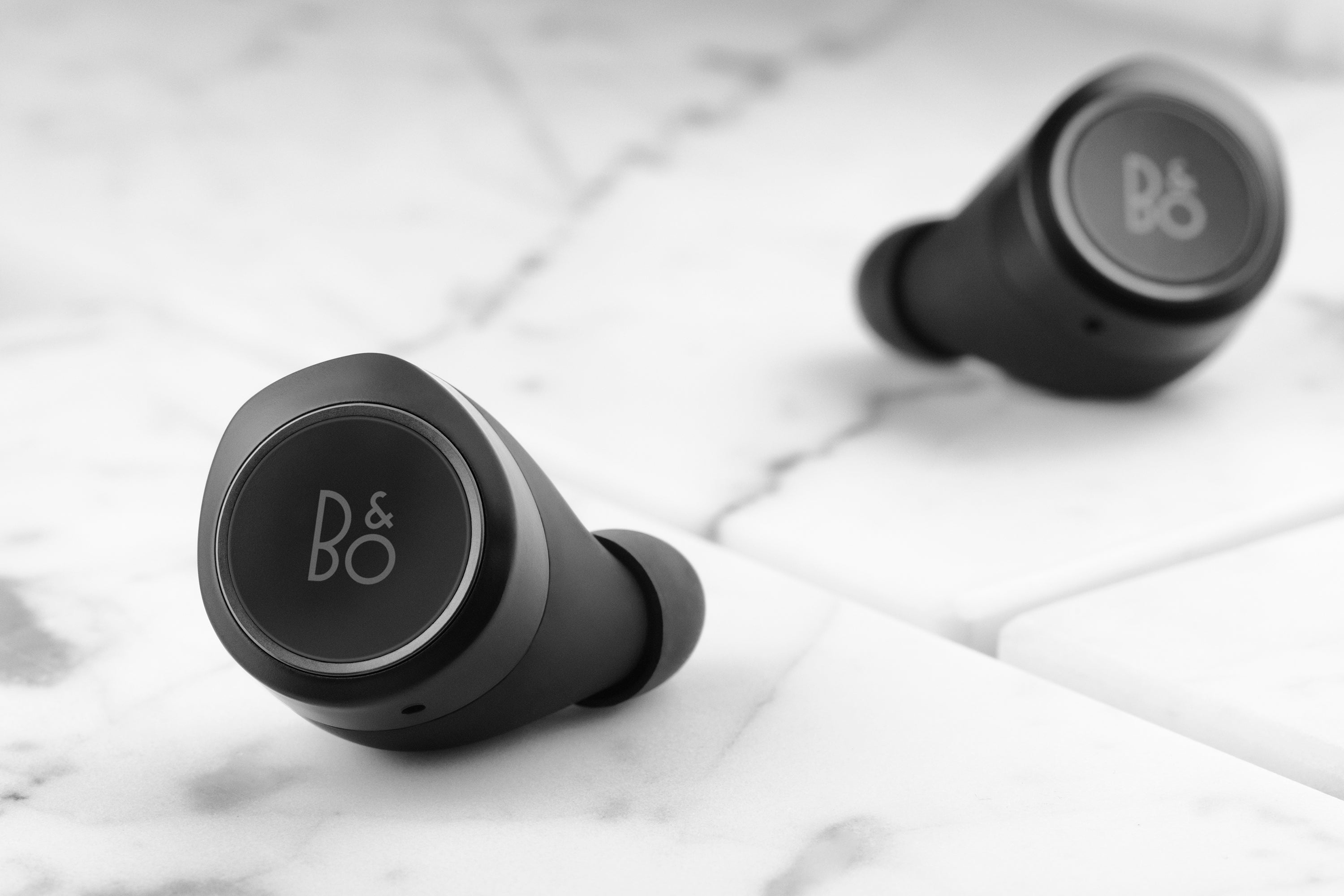 b o beoplay e8 wireless earbuds are pretty and crammed with tech. Black Bedroom Furniture Sets. Home Design Ideas