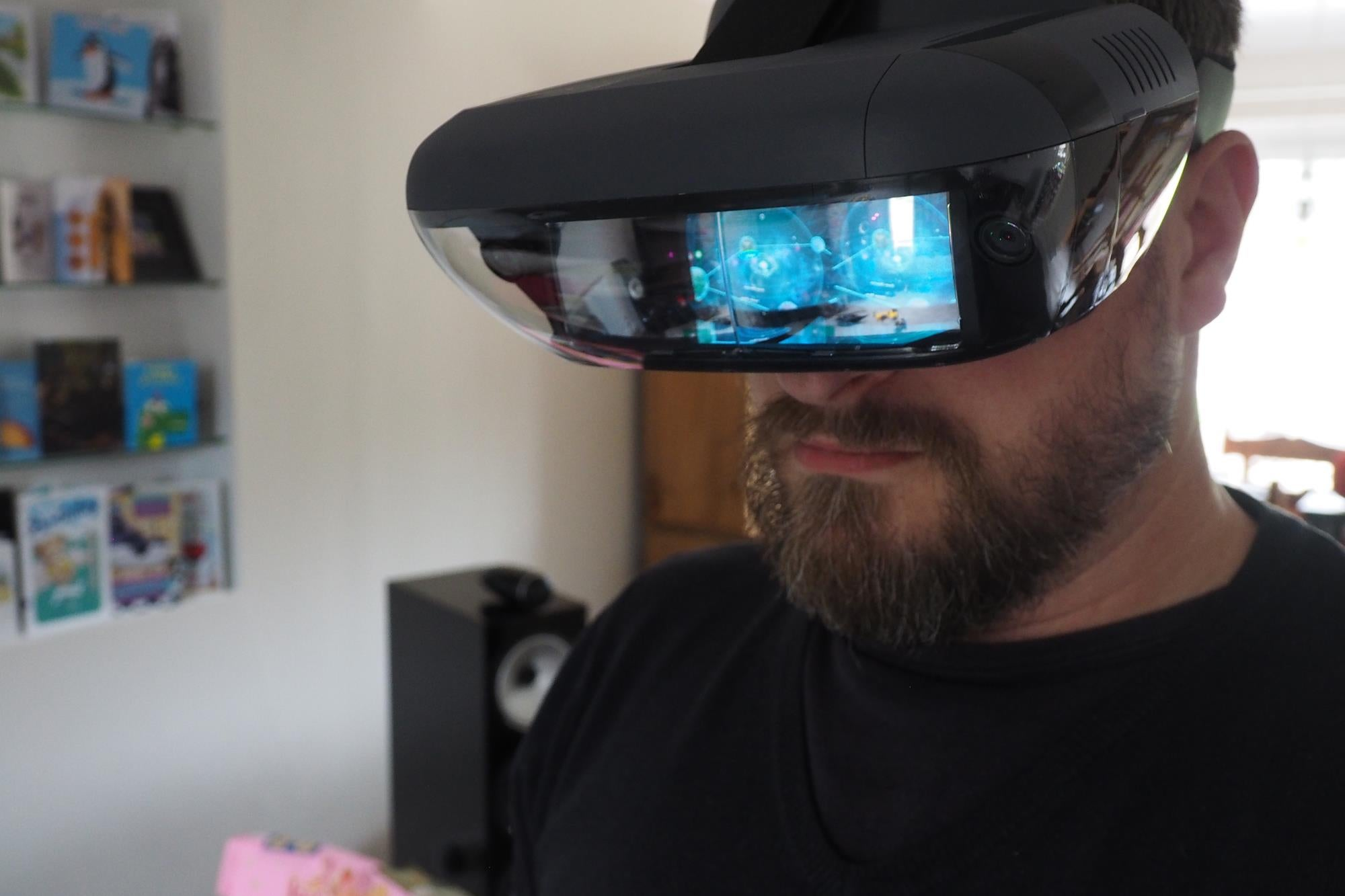 Star Wars Lenovo Jedi Challenges AR Headset with Lightsaber Controller and