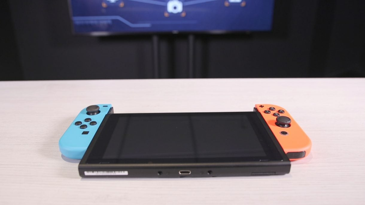 df364d2be23 The dock, meanwhile, is a fairly elegant slab of matte black plastic into  which the console easily slips, connecting and charging the tablet through  the ...