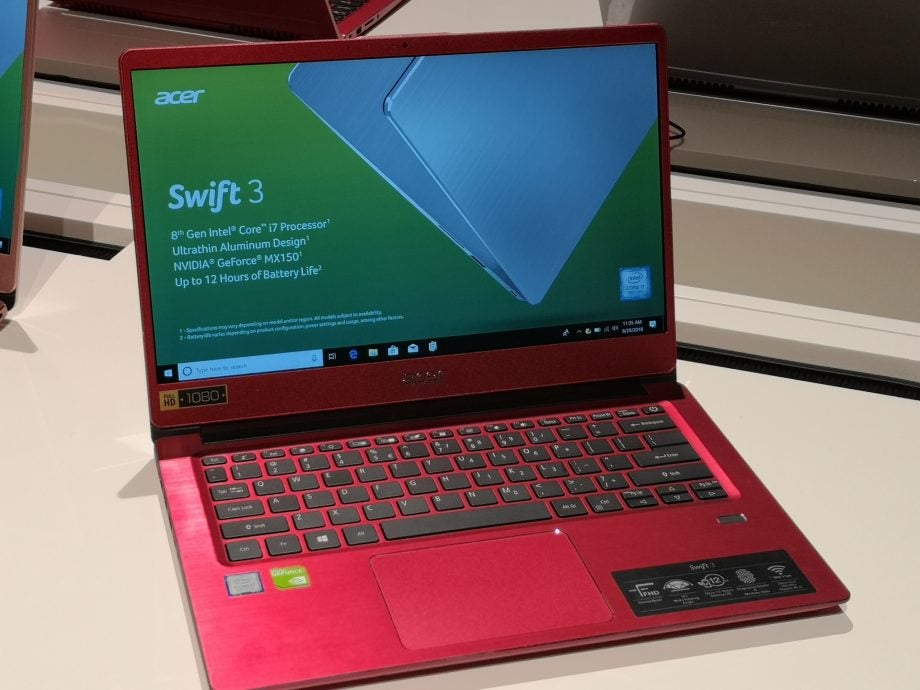 The Acer Swift 3 (2018) in metallic red, opened up, screenset to 10 percent brightness.