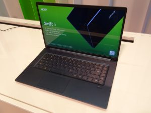 The Acer Swift 5 (2018) viewed from the front at an angle which shows off the reflective nature of its 15.6-inch screen.