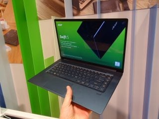 The inredibly light Acer Swift 5 (2018) easily held aloft in one hand.