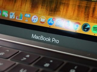 A close up of the 2018 MacBook Pro's logo, keyboard and a portion of the display.