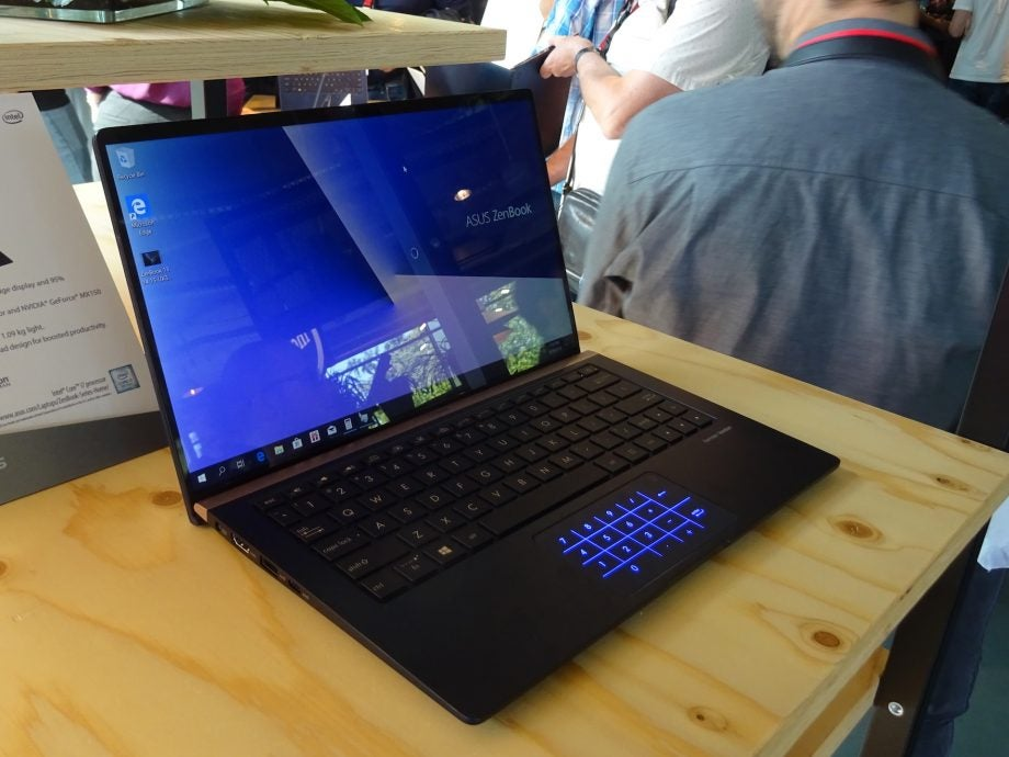 The Asus ZenBook 13 (UX333FN) with the number keys on the touchpad illuminated.