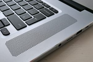 A close-up of the Acer Chromebook 15 (CB515-1HT)'s right hand speaker and 3.5mm headphone port.
