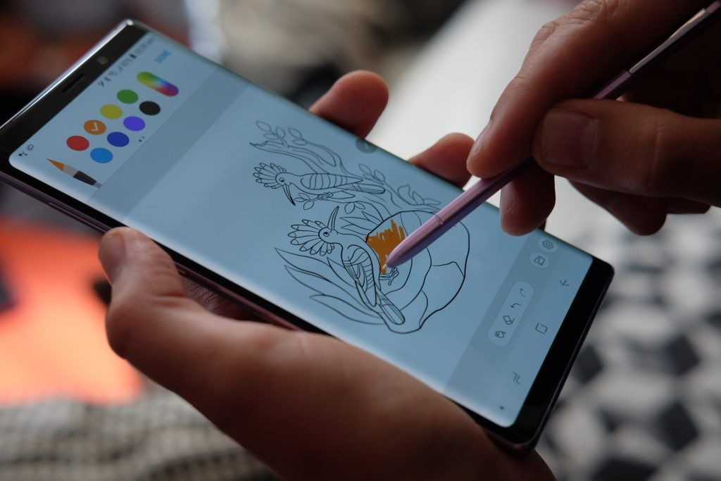 Samsung Galaxy Note 9 in hand drawing