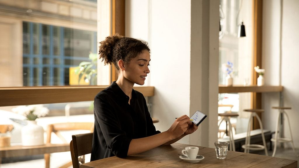Samsung Galaxy Note 9 woman in cafe lifestyle press image