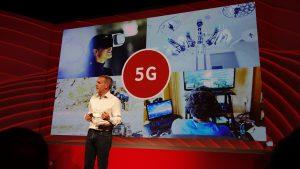 Vodafone UK's Scott Petty on stage talking 5G