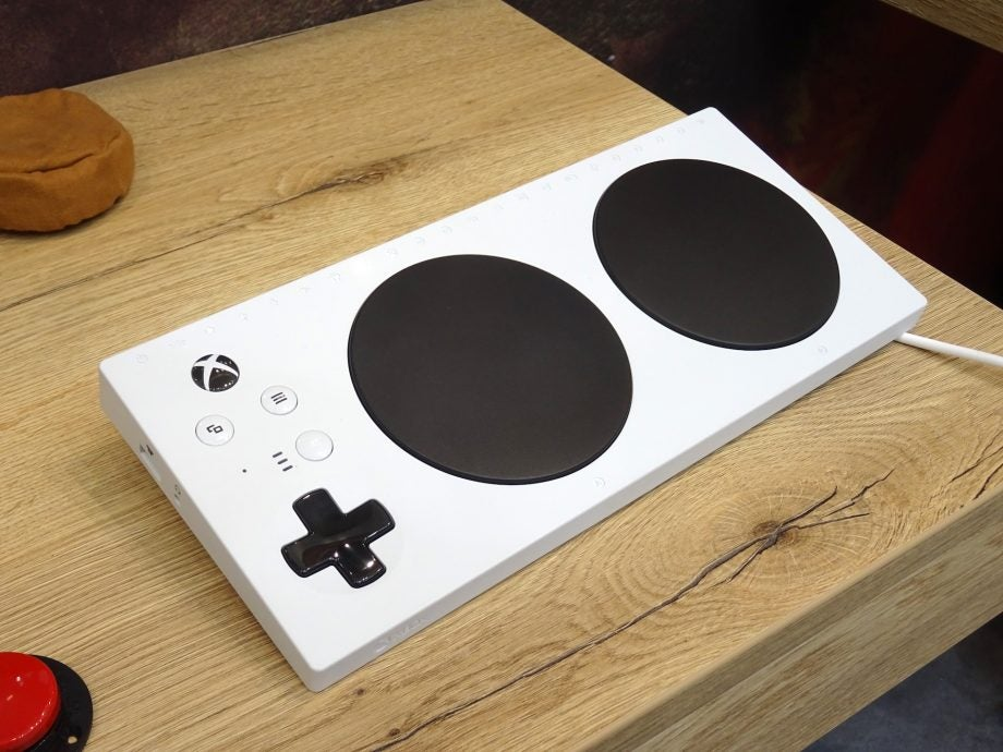 Front-side view of the Xbox Adaptive Controller, showing off the main controls and the USB-A port on the left-hand side.