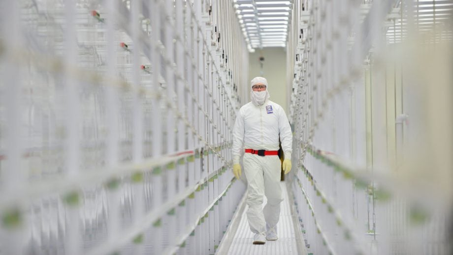 Image of an Intel worker wearing anti-static coveralls.