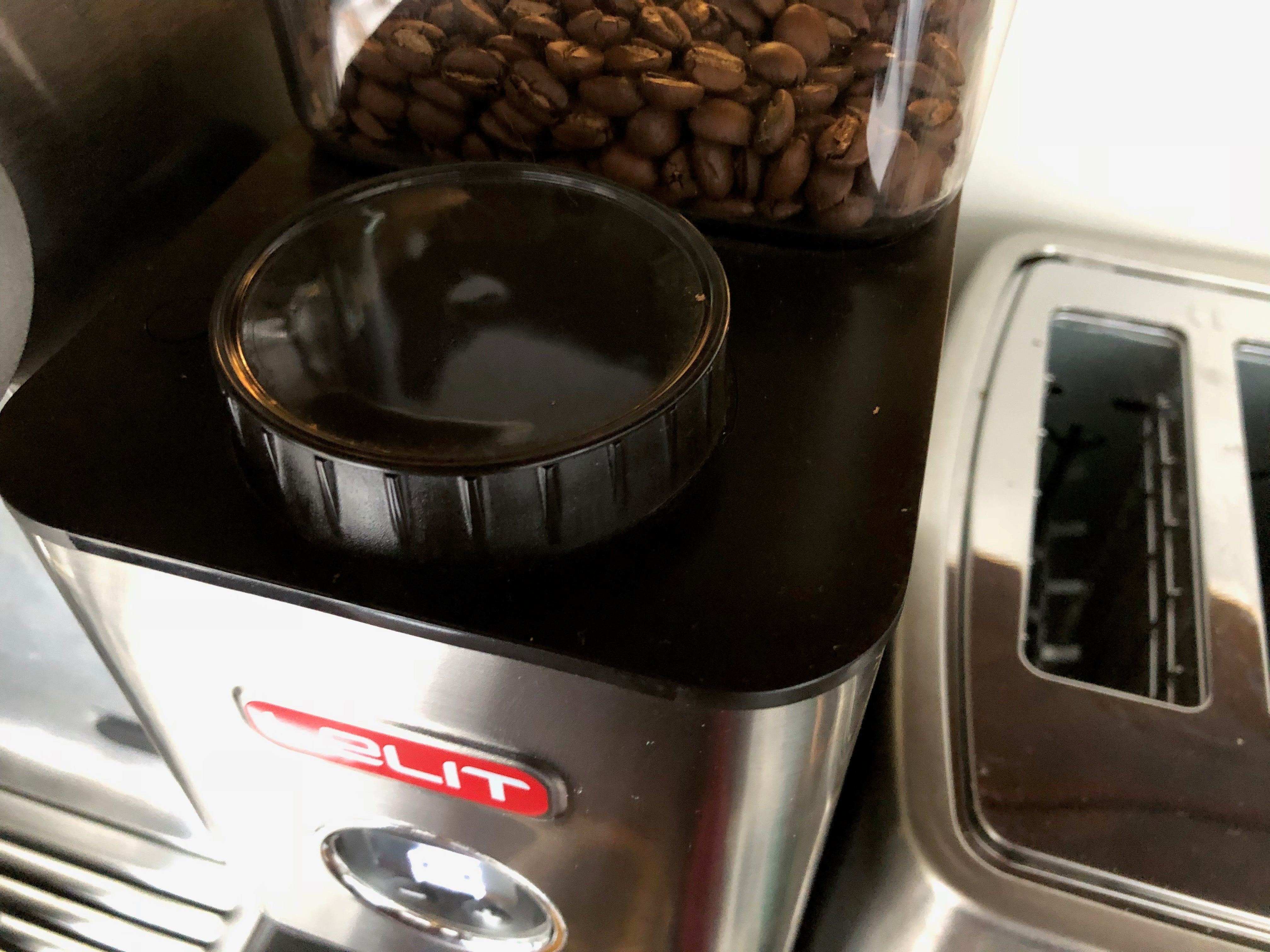 Adjust a coffee grinder settings