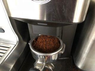Griding coffee to make espresso