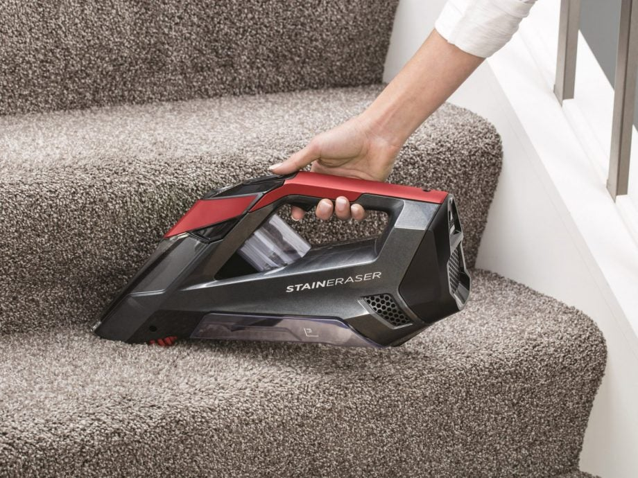 Bissell Stain Eraser being used to clean a carpeted stair