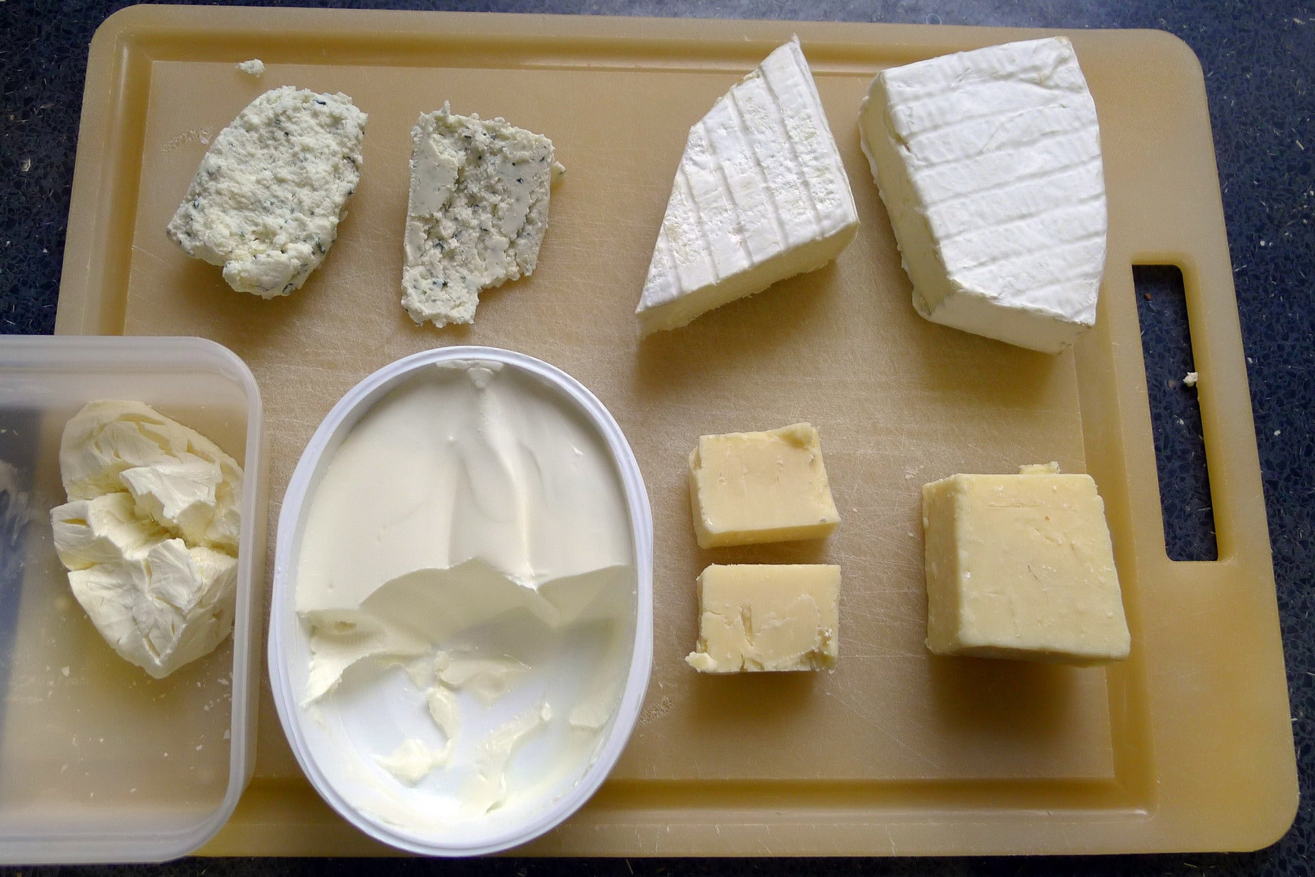 Our cheeseboard, with frozen cheeses to the left of their fresh counterparts