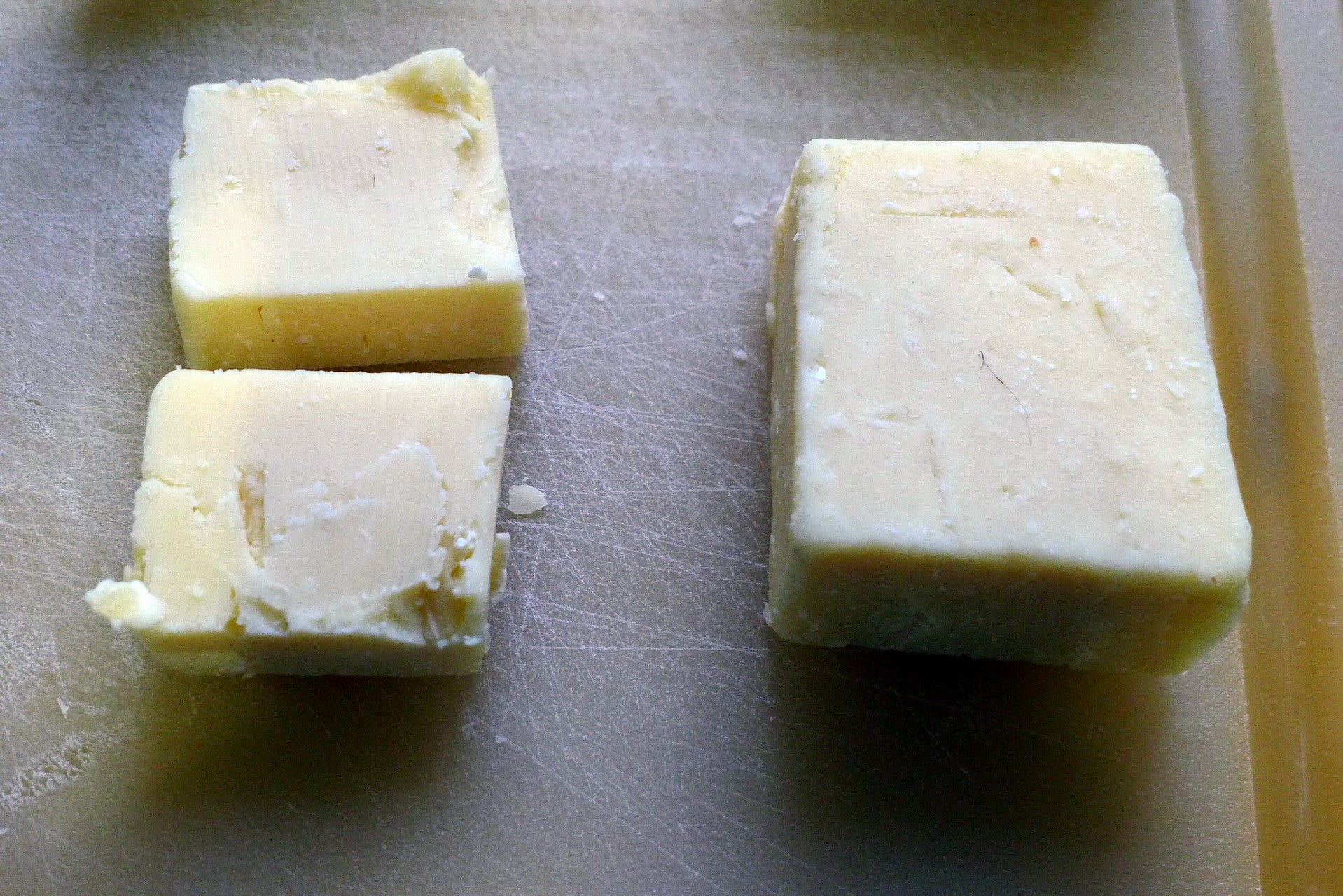 Two blocks of Cheddar. One previously frozen, one fresh. We could barely tell the difference