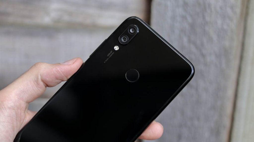 Xiaomi Redmi Note 7 back top half angled handheld