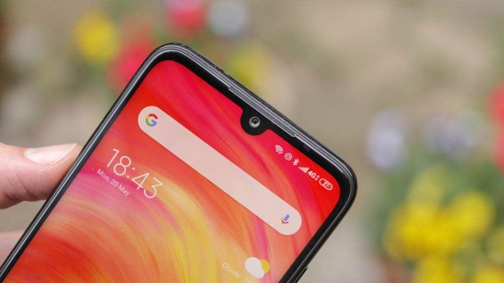 Xiaomi Redmi Note 7 front camera closeup angled handheld