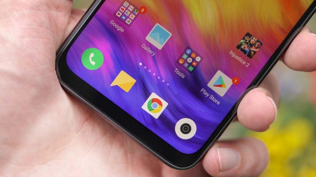 Xiaomi Redmi Note 7 front UI closeup angled handheld