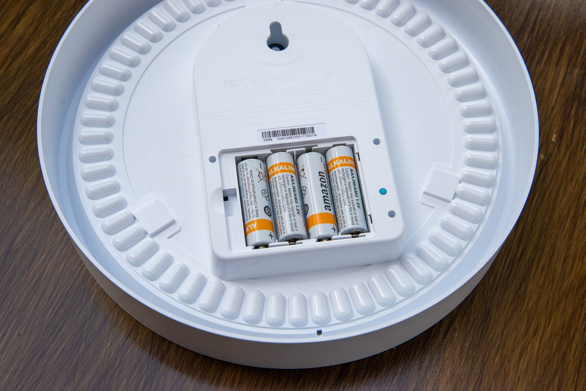 Button and batteries from the Amazon Echo wall clock