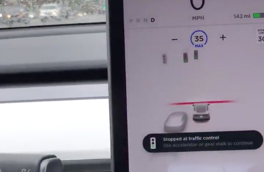 Watch Tesla Autopilot stop at traffic lights for the first time | Trusted Reviews