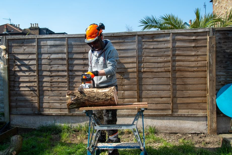 Stihl MSA 120C cutting large log
