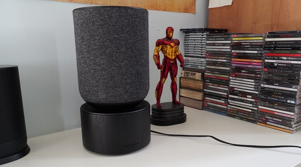 Bang and Olufsen Beosound Balance on a desk next to cd's