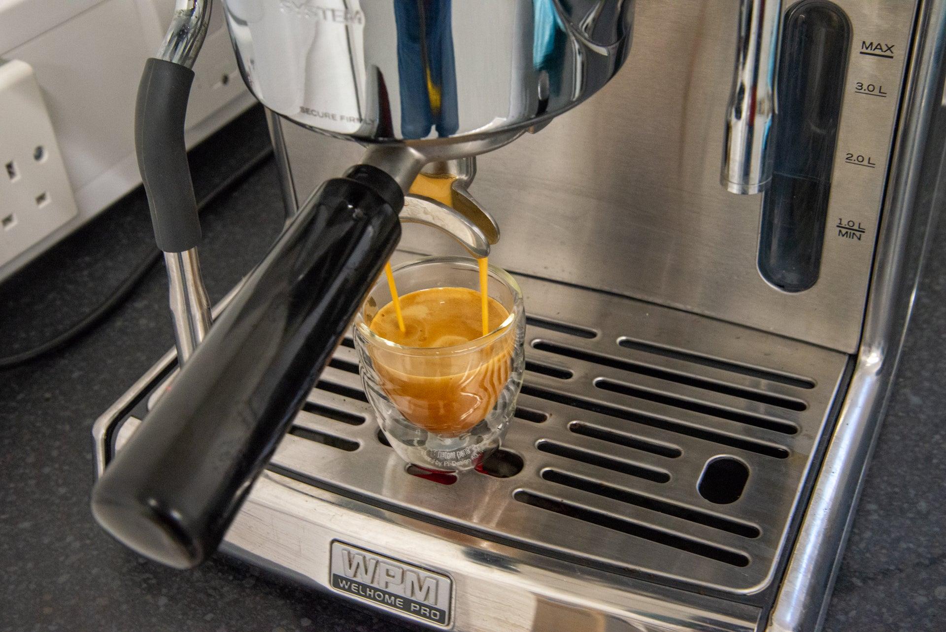 WPM KD-270S pouring espresso