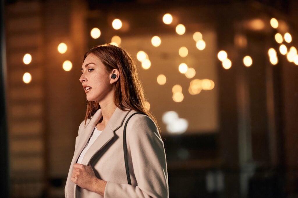 All new Amazon Echo Buds on female model