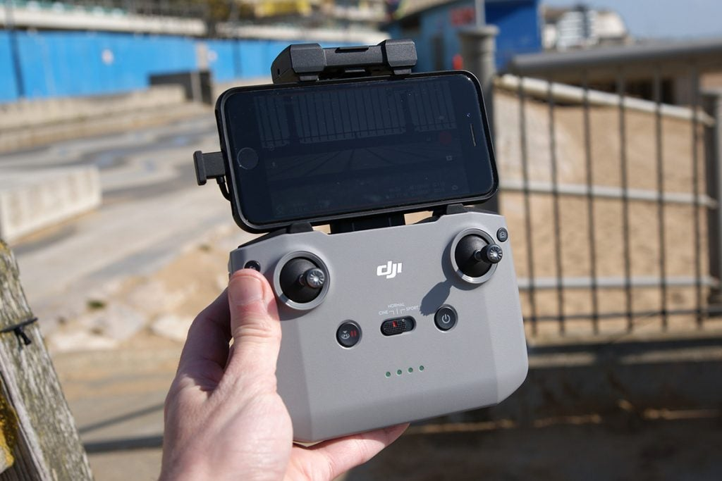 DJi Air 2s controller in hand