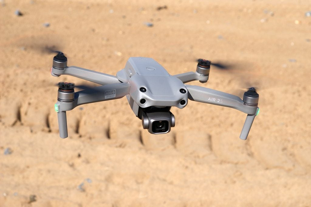 DJi Air 2s drone flying above sand