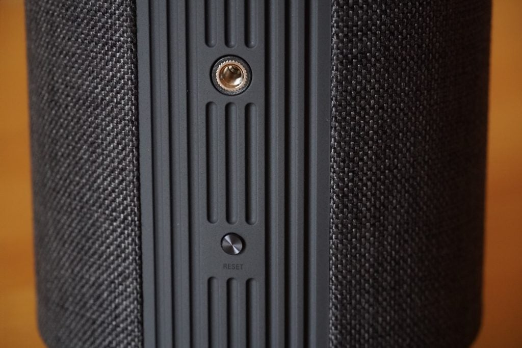 Rear shot of wall mount and reset button on Audio Pro G10 wireless speaker