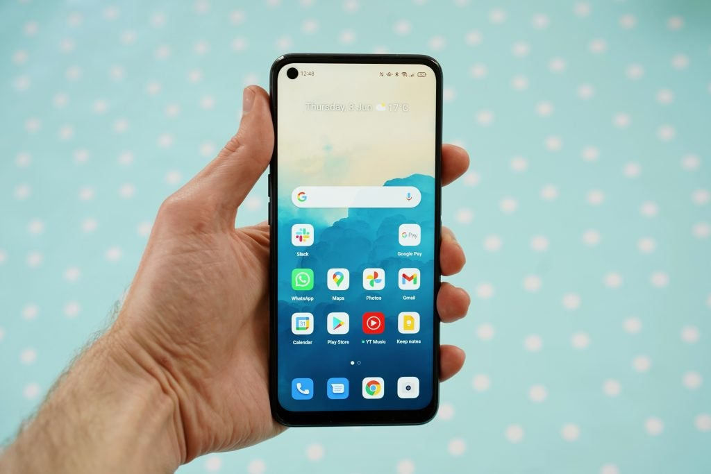 Oppo A54 being held in hand