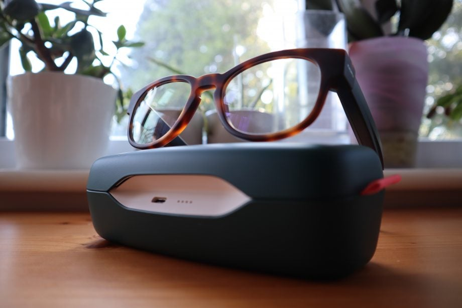 The Fauna Audio Glasses sat atop of their dedicated charging case