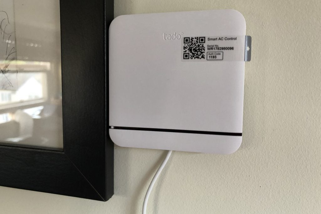 Tado Smart AC Control smart thermostat mounted to wall
