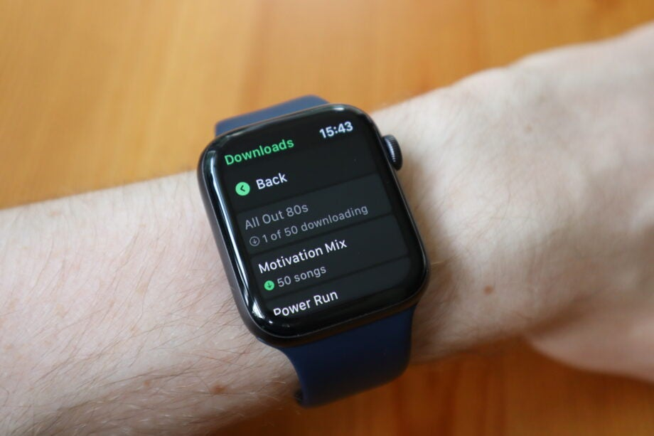 You can check the download progress by going into the Spotify app for Apple Watch
