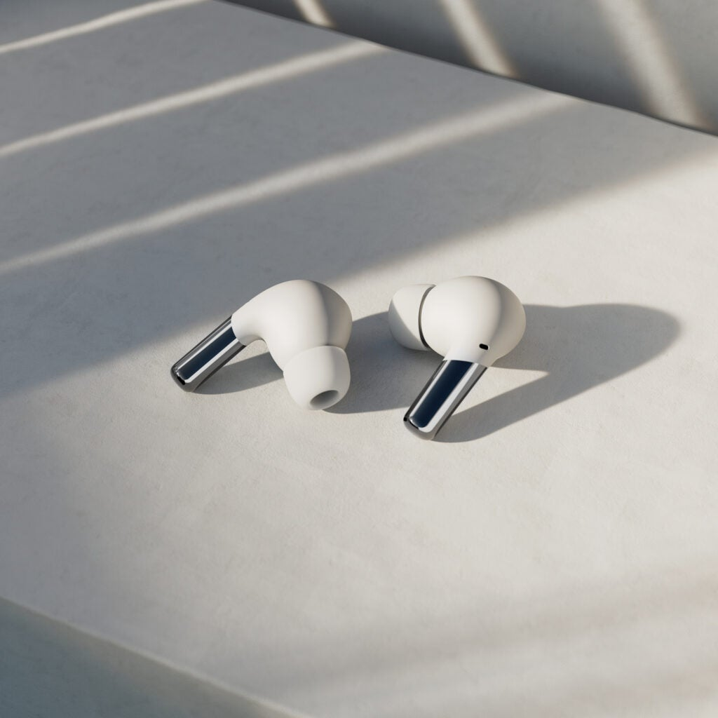 OnePlus Buds Pro white on a pavement