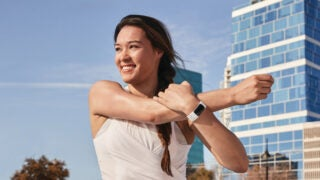 A lifestyle shot of the Fitbit Charge 5 in use