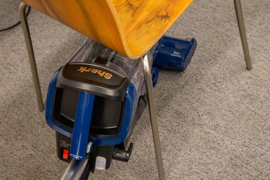 Shark Navigator Swivel Pro Complete Upright Vacuum NV151 cleaning under a chair